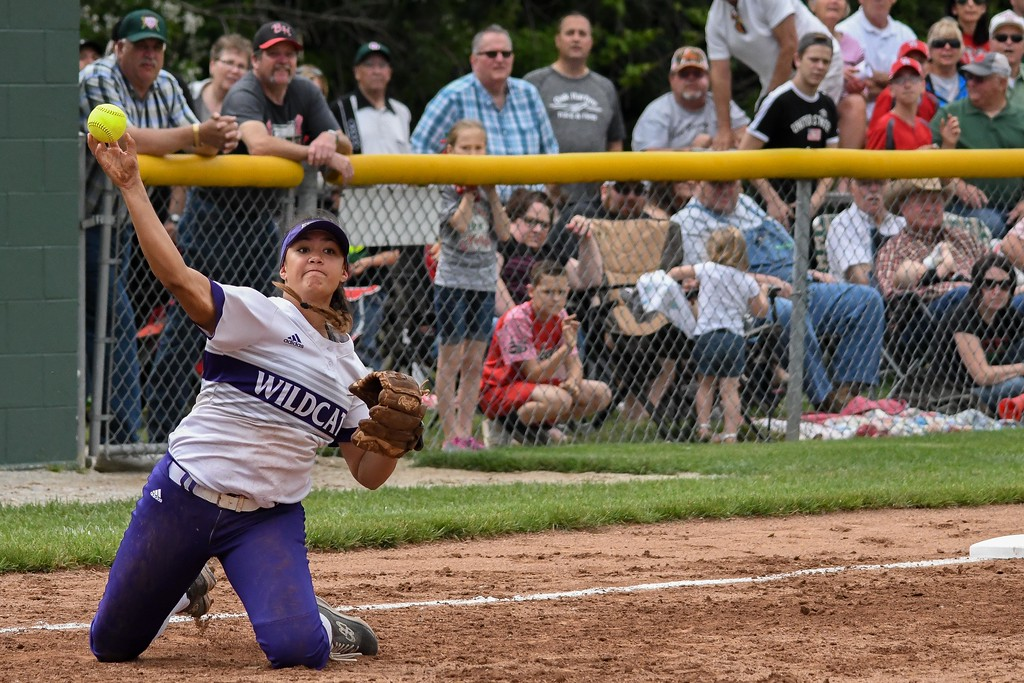 . Eric Bonzar�The Morning Journal<br> Keystone\'s Sammie Stefan throws from her knees to first base for the out against Oak Harbor on May 27.