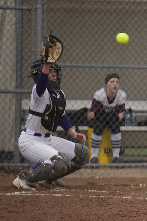 . Jen Forbus - The Morning Journal<br> Wildcat catcher Autumn Acord reaches to stop a high pitch against Wellington on April 24.