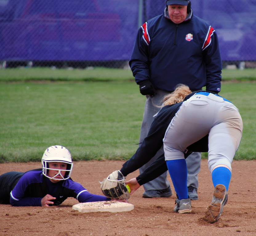 . Jon Behm - The Morning Journal<br> Keystone\'s Autumn Acord holds onto second as the tag is applied late by Midview\'s Gabby Shackelford at LaGrange Community Park during the Prebis Memorial Classic on April 28.
