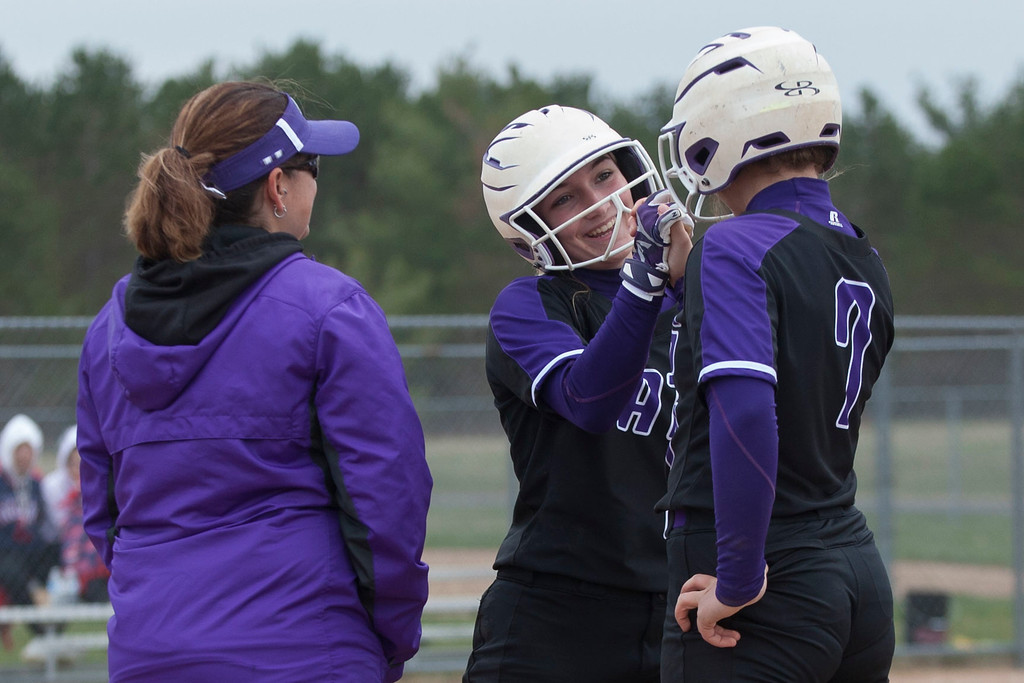 . Jen Forbus - The Morning Journal<br> Keystone base runners Autumn Acord (7) and Marlie McNulty celebrate at first base against Akron SVSM on April 14.
