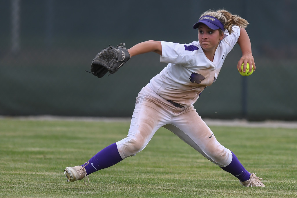 . Eric Bonzar�The Morning Journal<br> Keystone junior Autumn Acord comes up firing from center field against Defiance on May 26.