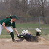 Jen Forbus - The Morning Journal<br> Keystone's Autumn Acord kicks up dirt sliding safely into second against Akron SVSM on April 14.