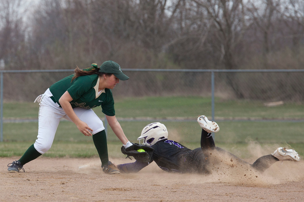 . Jen Forbus - The Morning Journal<br> Keystone\'s Autumn Acord kicks up dirt sliding safely into second against Akron SVSM on April 14.