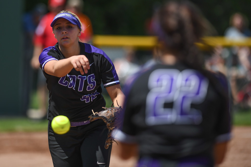 . Eric Bonzar�The Morning Journal<br> Keystone pitcher Sydney Campbell tosses the ball to first baseman Brooke Piazza for the out against Oak Harbor on May 24.