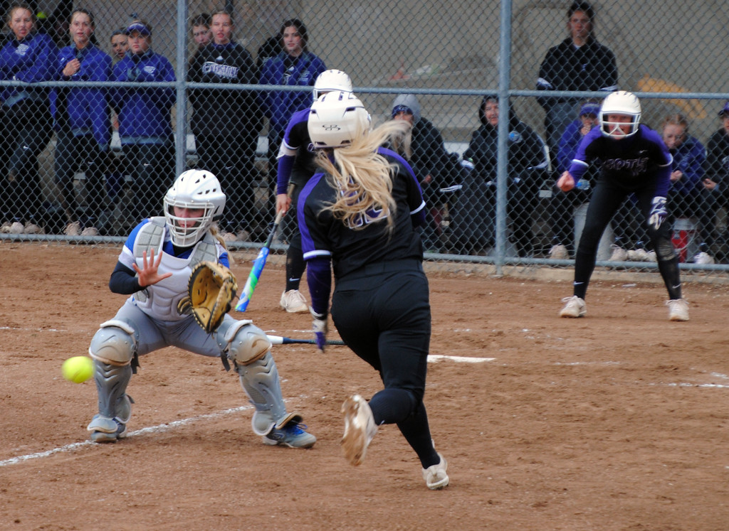 . Jon Behm - The Morning Journal<br> Keystone\'s Marlie McNulty tries to get around Midview catcher Ella Leonard at LaGrange Community Park during the Prebis Memorial Classic on April 28. McNulty scored on the play.