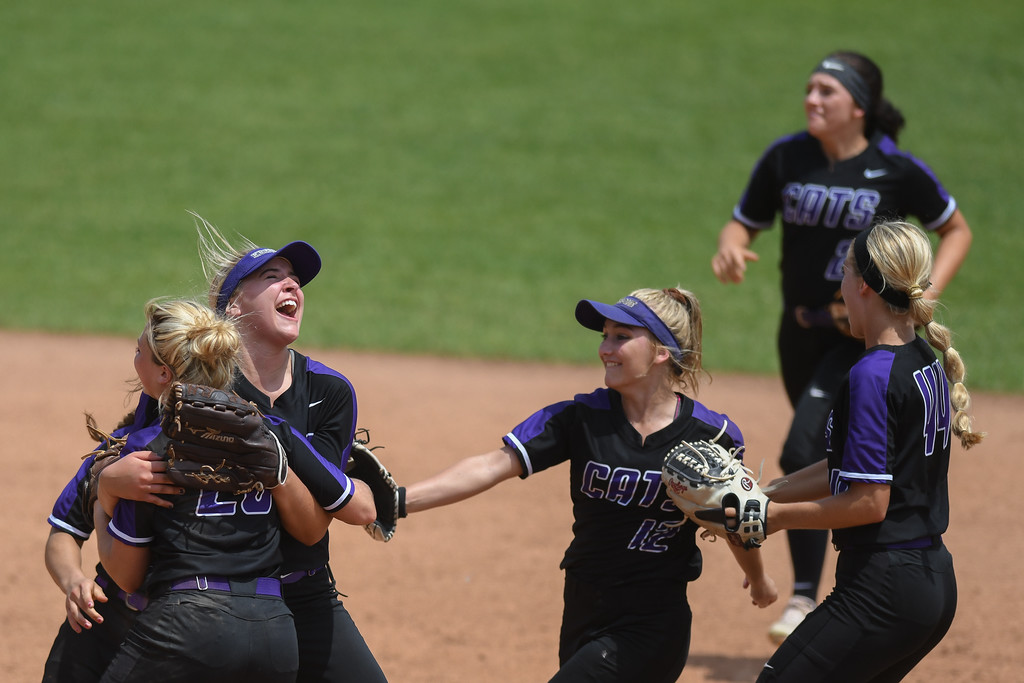 . Eric Bonzar�The Morning Journal<br> Keystone pitcher Sydney Campbell hugs teammate Ali Pyles (29) after Pyles caught the final out of the game, giving the Wildcats a 1-0 win over Fairfield Union, May 31, 2018. The Wildcats advanced to their seventh state title appearance, in school history, with the win over the Falcons.