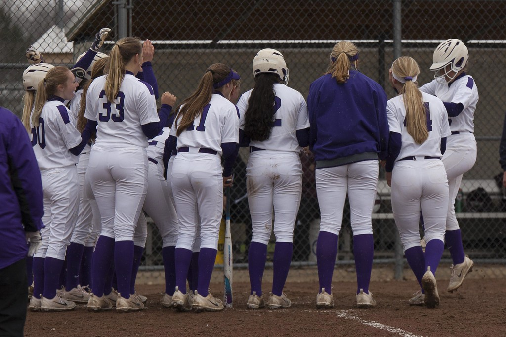 . Jen Forbus - The Morning Journal<br> Keystone welcomes Autumn Acord over home plate after she rounded the bases on a grand slam against Wellington on April 24.