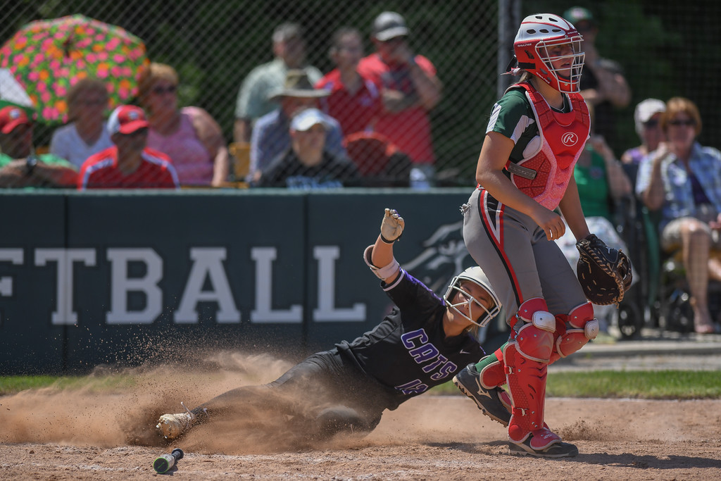 . Eric Bonzar�The Morning Journal<br> Keystone\'s Marlie McNulty slides into home plate and scores on an RBI by Madi Herrington in the sixth inning against Oak Harbor on May 24.
