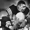 East's Bill Putney of Mentor is tackled by West defenders Mike Ball (52) of Wickliffe and Andy Babic of Kirtland.