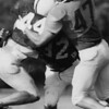 Riverside's Ace Singleton (47) and Perry's Corey Sarosy (32) tackle Madison's John Hedges (44) during a 1995 practice.