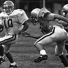 West QB Mike Linc eludes Brian Hoeth of Mentor in 1992.