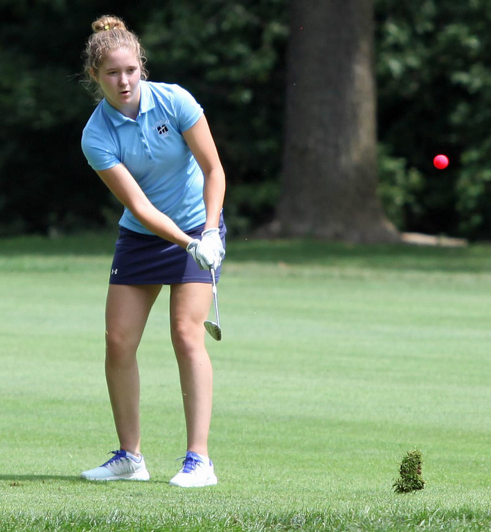 . Randy Meyers - The Morning Journal Grace Boccia of Magnificat chips the ball onto the green during the OGGF Showcase on Monday at the Avon Oaks Country Club