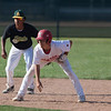 Jen Forbus - The Morning Journal<br> Amherst short stop Josh Qualls keeps a close eye on Elyria's Gage Barbee leading off on second on July 25.