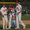 Jen Forbus - The Morning Journal<br> Elyria relief pitcher Hunter Osborne (23) gets some encouragement from his infield, including short stop Evan Engle (6) on July 25.