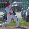 Jen Forbus - The Morning Journal<br> Elyria's Chris Willis swings low to connect with a pitch on July 25.