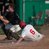 Jen Forbus - The Morning Journal<br> Amherst's Eric Ritter waits for the throw that doesn't come in time to stop Elyria's Evan Engle from scoring the game's only run on July 25.
