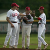 Jen Forbus - The Morning Journal<br /> Elyria's infield is ready to start the new inning.