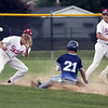 Jen Forbus - The Morning Journal<br /> Pioneer Hunter Olsen is positioned for the throw to second, but Titan Yandel Ramirez slides safely to the bag.