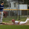 Jen Forbus - The Morning Journal<br />  Pioneer Chris Willis dives head-first into third base.