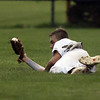 Jen Forbus - The Morning Journal<br />  In an acrobatic performance, Elyria right fielder Hunter Osborne comes up with the ball for an out.