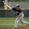 Jen Forbus - The Morning Journal<br /> On the mound for the Titans, Corey Thompson delivers a pitch in the rain.
