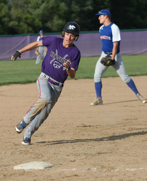 . Randy Meyers - The Morning Journal Keystone\'s Nate Archer will touch third and score against Bay on Thursday during the Amherst summer classic