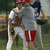 Jen Forbus - The Morning Journal<br />  Elyria's Coach Piazza playfully checks on Chris Willis at third base.