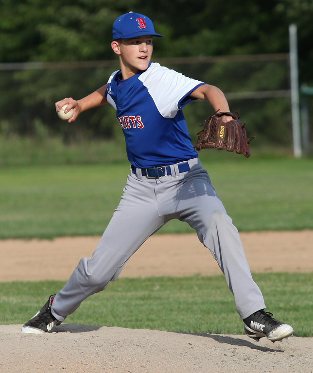 . Randy Meyers - The Morning Journal Lucas Shell of Bay pitches in relief against Keystone on Thursday at the Amherst Summer Classic.