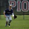 Jen Forbus - The Morning Journal<br />  Lorain's Yandel Ramirez snags a hit to right field.