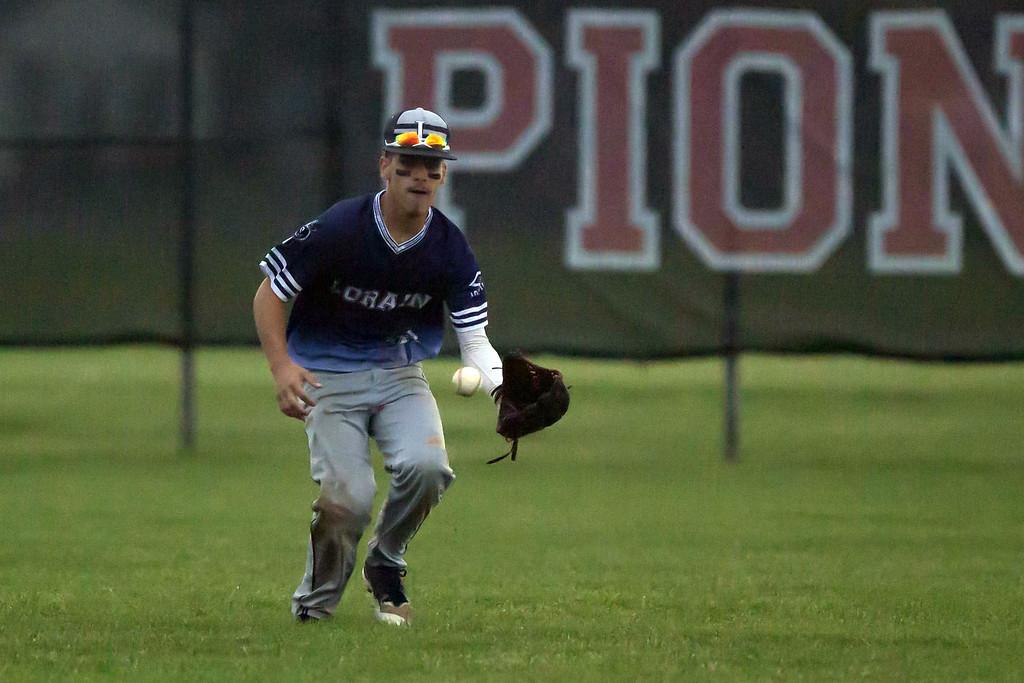 . Jen Forbus - The Morning Journal  Lorain\'s Yandel Ramirez snags a hit to right field.