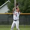 Jen Forbus - The Morning Journal<br />  Elyria short stop Evan Engle waits beneath an infield pop-up to make the out.
