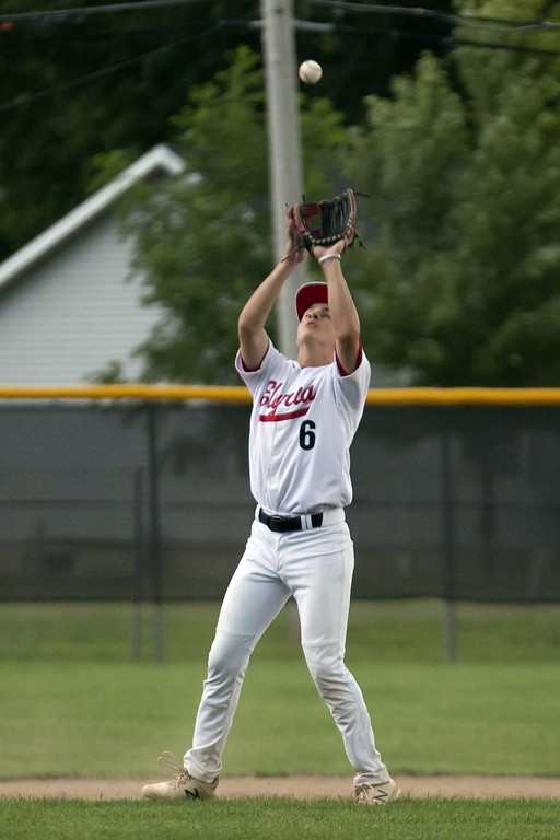 . Jen Forbus - The Morning Journal  Elyria short stop Evan Engle waits beneath an infield pop-up to make the out.
