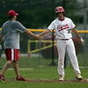 Jen Forbus - The Morning Journal<br /> Elyria's Gage Barbee gets a congratulatory hand slap from Coach Piazza at third base.