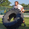 Paul DiCicco - The News-Herald<br /> enior Jared Szinte, dominates the tire relay at Devil Dog Soldier workouts on July 27.