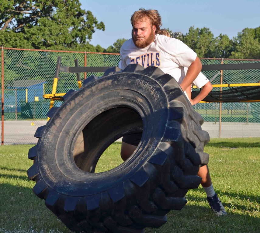 . Paul DiCicco - The News-Herald enior Jared Szinte, dominates the tire relay at Devil Dog Soldier workouts on July 27.