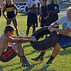Paul DiCicco - The News-Herald<br />  Freshmen Chase Fortkamp (left) and Gino Carroscia, face off in tire tug-of-war during Devil Dog Soldier workouts on July 27.