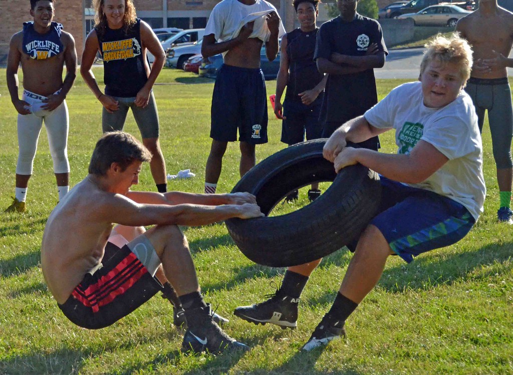. Paul DiCicco - The News-Herald  Freshmen Chase Fortkamp (left) and Gino Carroscia, face off in tire tug-of-war during Devil Dog Soldier workouts on July 27.