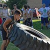 Paul DiCicco - The News-Herald<br /> Freshman Mike Moon lifts the truck tire during the truck-tire-relay at Devil Dog Soldier workouts on July 27.