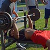 Paul DiCicco - The News-Herald<br />  Junior Running Back, Isaac Pettway benches 185 pounds during the Devil Dog Soldier workouts on July 27.
