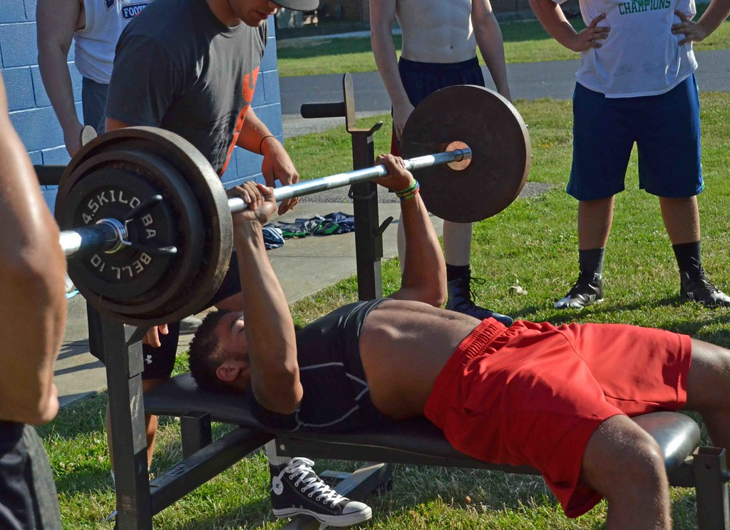 . Paul DiCicco - The News-Herald  Junior Running Back, Isaac Pettway benches 185 pounds during the Devil Dog Soldier workouts on July 27.