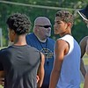 Paul DiCicco - The News-Herald<br />  Assistant Coach and 1980 Alum, Mark Hopton, giving instruction during the Devil Dog Soldier non-mandatory workouts.