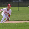 Randy Meyers - The Morning Journal<br /> Elyria infielder Kevin Reddinger eyes a high bouncing ground ball against Bay on Saturday
