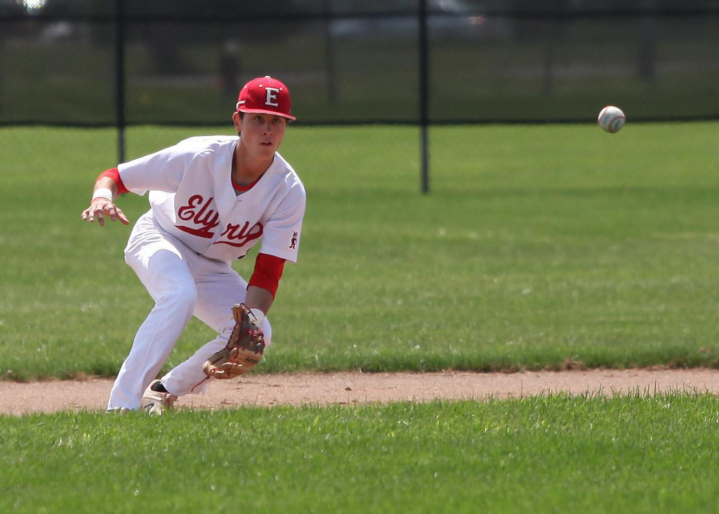 . Randy Meyers - The Morning Journal Elyria infielder Kevin Reddinger eyes a high bouncing ground ball against Bay on Saturday