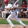 Randy Meyers - The Morning Journal<br /> Cameron Brubaker of Elyria delivers a base hit against Bay on Saturday during the Amherst Summer Classic