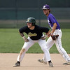 Jen Forbus - The Morning Journal<br /> Amherst's Conner Emch is all smiles as he leads off at second with Keystone short stop Cameron Emerick keeping a close eye on him.