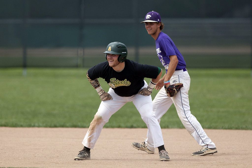 . Jen Forbus - The Morning Journal Amherst\'s Conner Emch is all smiles as he leads off at second with Keystone short stop Cameron Emerick keeping a close eye on him.