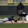 Jen Forbus - The Morning Journal<br /> Comet pitcher Kyle Dalzell makes the throw to first baseman Caleb McGee to catch Keystone's baserunner before he could get back to first.