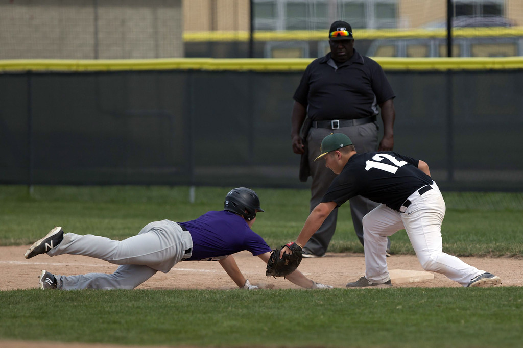 . Jen Forbus - The Morning Journal Comet pitcher Kyle Dalzell makes the throw to first baseman Caleb McGee to catch Keystone\'s baserunner before he could get back to first.