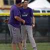 Jen Forbus - The Morning Journal<br /> Wildcat Nate Archer gets an atta boy from his coach after reaching third base.