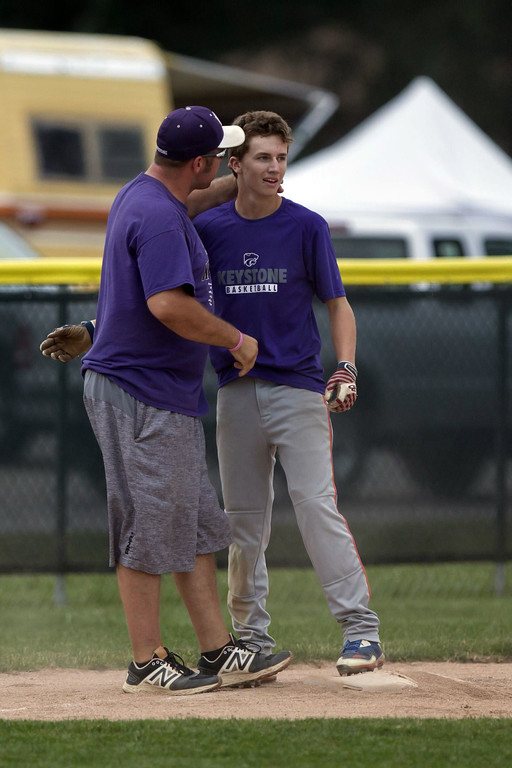 . Jen Forbus - The Morning Journal Wildcat Nate Archer gets an atta boy from his coach after reaching third base.